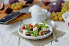 Salad with goat chees, arugula and figs. Royalty Free Stock Photos