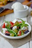 Salad with goat chees, arugula and figs. Royalty Free Stock Photography