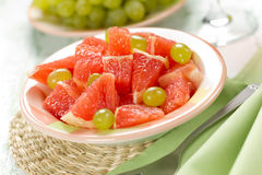 Salad with grapefruit and grapes Royalty Free Stock Photography