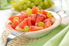 Salad with grapefruit and grapes Royalty Free Stock Image