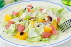 Salad with grapefruit, oranges, iceberg lettuce and grated chees Royalty Free Stock Photos