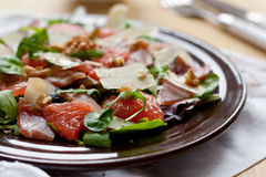 Salad with grapefruit parmesan and rucola Royalty Free Stock Photos