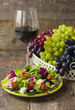 Salad with grapes, herbs, walnuts and blue cheese and a glass of Royalty Free Stock Photography