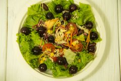 Salad with grapes on the plate stock photography