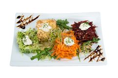 Salad of grated carrots, apple, beets and celery. Royalty Free Stock Photos