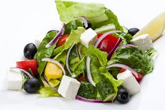 Salad `Greek` on a white plate stock photography