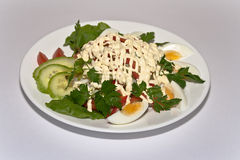 Salad green. Green salad with eggs onions and cucumbers Stock Photo