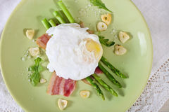 Salad with green asparagus with poached egg Royalty Free Stock Images