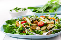 Salad with green asparagus and vegetables. Salad with green asparagus and wild garlic dip Stock Image