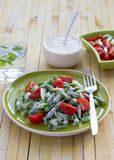 Salad of green beans and cherry tomatoes Stock Image