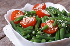 Salad of green beans, cherry tomatoes and sesame Stock Photo