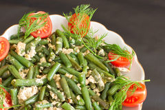 Salad of green beans with eggs and tomatoes. Stock Image