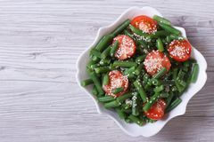 Salad of green beans and sesame seeds top view Stock Photos