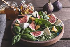 Salad with green, figs, cheese vegetarian dish Royalty Free Stock Photo