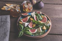 Salad with green, figs, cheese vegetarian dish Stock Image