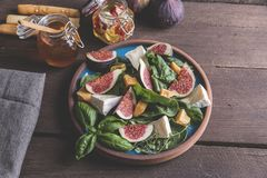 Salad with green, figs, cheese vegetarian dish Stock Images