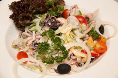 Salad with green lettuce, red onion, slices and seafood Stock Images