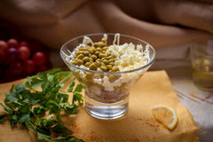 Salad with green pea. Fresh Salad with green pea, egg, ham Royalty Free Stock Photography