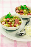 Appetizer of green peas, smoked sausage and pickle Royalty Free Stock Photography
