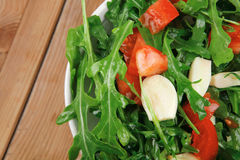 Salad : green salad with raw tomato and garlic Stock Image