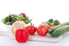 Salad Greens in Bowl with Vegetables on Board Stock Image