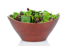 Salad Greens in Wood Bowl Royalty Free Stock Images