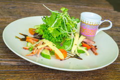 Salad with greens. On wooden table Stock Photo