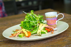 Salad with greens. On wooden table Royalty Free Stock Image