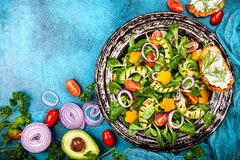 Salad with grilled avocado stock photos