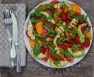 Salad of grilled avocado and multicolored tomatoes Royalty Free Stock Photos