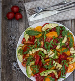 Salad of grilled avocado and multicolored tomatoes Stock Photos
