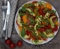 Salad of grilled avocado and multicolored tomatoes Royalty Free Stock Photography