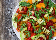 Salad of grilled avocado and multicolored tomatoes Royalty Free Stock Images