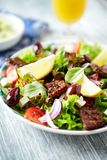 Salad with Grilled Beef Pieces royalty free stock photo