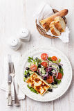 Salad with grilled cheese Royalty Free Stock Images