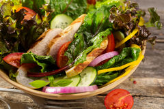 Salad with grilled chicken fillet and vegetables Royalty Free Stock Images
