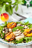 Salad with grilled halloumi cheese and peaches Royalty Free Stock Images