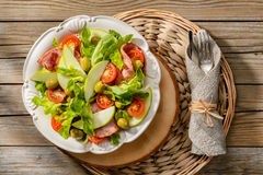 Salad with grilled ham, tomatoes, apples and green olives Royalty Free Stock Photo