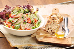 Salad with grilled loin, arugula and vinegar dip Stock Photography