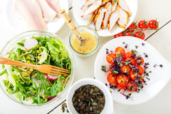 Salad with grilled meat, smoked fish and different vegetables. Royalty Free Stock Photo