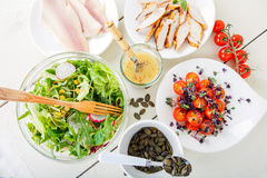 Salad with grilled meat, smoked fish and different vegetables. Stock Photo