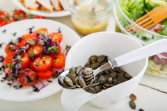 Salad with grilled meat, smoked fish and different vegetables. Stock Images