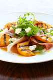 Salad with grilled peach and ham Royalty Free Stock Image