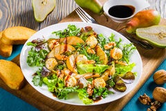 Salad with grilled pears, baby mozzarella balls, oakleaf lettuce and walnuts Royalty Free Stock Image