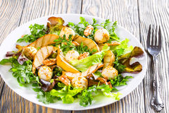Salad with grilled pears, baby mozzarella balls, oakleaf lettuce and walnuts Stock Images