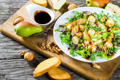 Salad with grilled pears, baby mozzarella balls, oakleaf lettuce and walnuts Royalty Free Stock Images