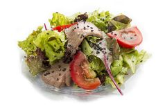 Salad with grilled veal in black sesame with oyster dressing. Asian Lunch royalty free stock images