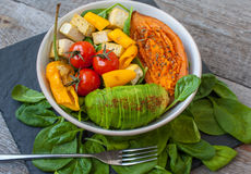 Salad with grilled vegetables: grilled sweet potatoes, tomatoes, avocados, spinach, tofu, Royalty Free Stock Photos