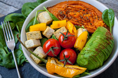 Salad with grilled vegetables: grilled sweet potatoes, tomatoes, avocados, spinach, tofu, Royalty Free Stock Images