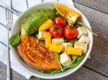 Salad with grilled vegetables: grilled sweet potatoes, tomatoes, avocados, spinach, tofu, Royalty Free Stock Photography